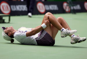 SPAIN'S MEDINA GARRIGUES FALLS DURING FOURTH ROUND MATCH AT AUSTRALIANOPEN IN MELBOURNE.